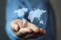 Hand holding world map. Hand holding white world map royalty free stock images