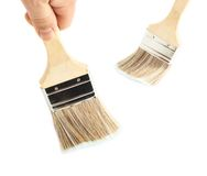 Hand holding a wide brush Royalty Free Stock Photo
