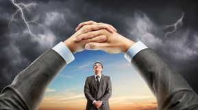 Hand holding window with man over sky royalty free stock photography