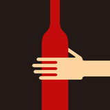 Hand holding a wine bottle Royalty Free Stock Images