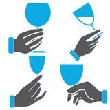 Hand holding wine glass Stock Photos