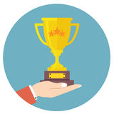 Hand holding winner cup vector Stock Image
