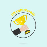Hand holding winner`s trophy award.Man holding up a gold trophy Royalty Free Stock Photo