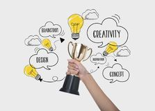 Hand holding winner trophy cup. concept for new ideas. With innovation and creativity royalty free stock photos