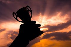 Hand holding winner trophy royalty free stock photography