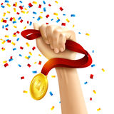 Hand holding winners medal award Royalty Free Stock Photos