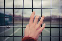 Hand holding wire fence Royalty Free Stock Photos