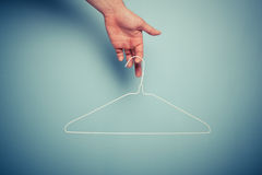 Hand holding wire hanger Stock Photo