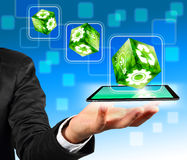 Hand holding wite green industrial cube. Businessman hand holding wite green industrial cube concept on a tablet pc Royalty Free Stock Images