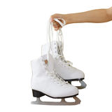 Hand holding woman ice skates isolated on a grey background stock photos