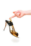 Hand holding woman shoe Stock Photo