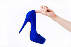Hand holding woman shoe Stock Photos