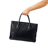 Hand holding women's leather handbag Royalty Free Stock Photography
