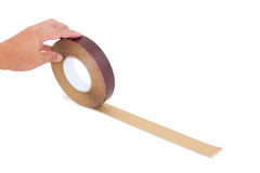 Hand holding wood tape isolated with clipping path Stock Image