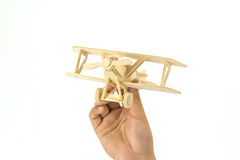 Hand holding a wooden airplane model Stock Image