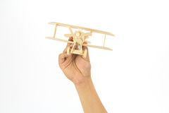 Hand holding a wooden airplane model Stock Photography