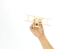 Hand holding a wooden airplane model Royalty Free Stock Images