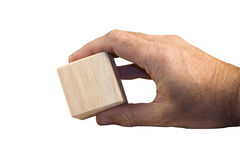 Hand holding wooden block Stock Image