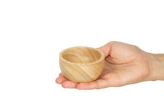 Hand holding wooden cup Stock Images
