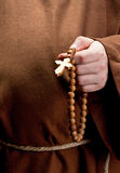 Hand holding wooden rosary Stock Images
