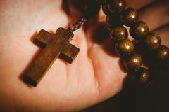 Hand holding wooden rosary beads Royalty Free Stock Image