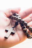 Hand holding wooden rosary beads Stock Photography