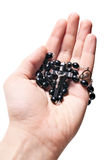 Hand holding wooden rosary with Catholic crucifix Royalty Free Stock Image