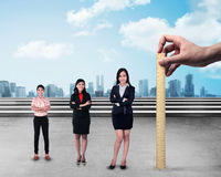 Hand holding wooden ruler, mesuring employee performance. Working appraisal concept Stock Images