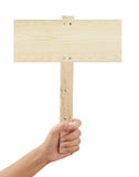 Hand holding wooden sign. Stock Photo