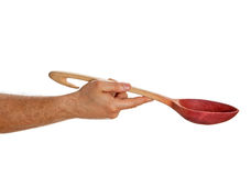 Hand holding wooden spoon Royalty Free Stock Photos