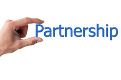 Hand holding the word partnership. Isolated on white backgound Royalty Free Stock Photography