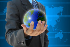 Hand holding a world. Businessman hand holding a world stock photography