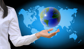 Hand holding a world. Working women hand holding a world stock images
