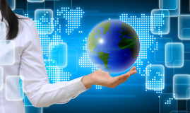 Hand holding a world. Working women hand holding a world stock image