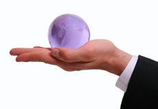 Hand Holding the World. Man's hand holding globe of world in hand stock photo
