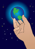 Hand holding world. Cosmic being holding earth with a backdrop of stars and space Stock Images