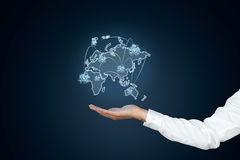Hand holding world map. A blue background royalty free stock photography