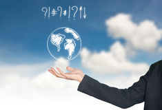 Hand holding world map icon. Against blue sky Royalty Free Stock Photos