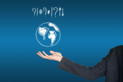 Hand holding world map icon. Earth on blue Stock Images