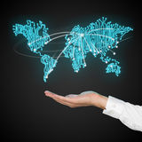 Hand holding world map. Hand holding microcircuit in form world map stock images