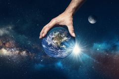 Hand holding the world. Symbol that God is in control of everything royalty free stock photo