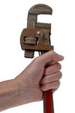 Hand holding a wrench Royalty Free Stock Photography