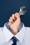 Hand holding Wrench Stock Photography