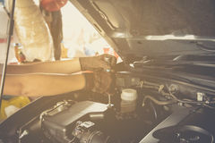 Hand holding a wrench with a car repairs ,professional auto mechanic Stock Photography