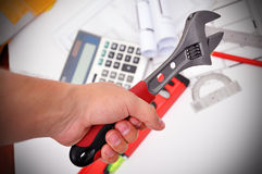 Hand holding wrench Royalty Free Stock Photography