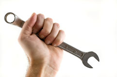 Hand holding wrench isolated. Stock Photo