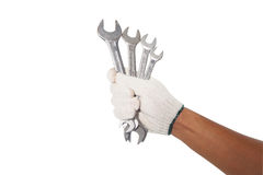 Hand Holding Wrenches include Path. Royalty Free Stock Photography