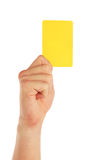 Hand holding yellow card Royalty Free Stock Images