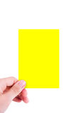 Hand Holding Yellow Card Stock Photography