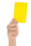 Hand holding yellow card up Stock Photography